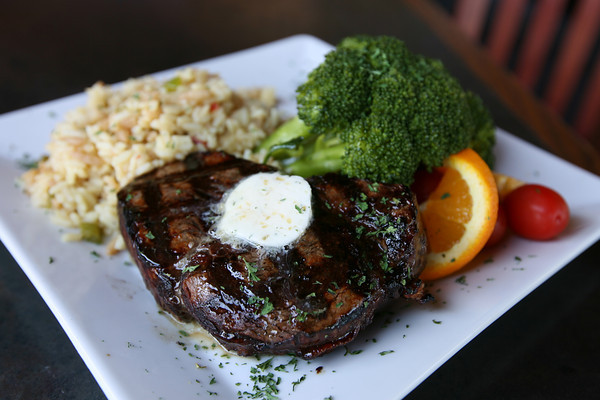A 9 oz. center-cut filet grilled and topped with garlic butter is served with the vegetable of the day and either rice or potato. Photo by Kate Glass