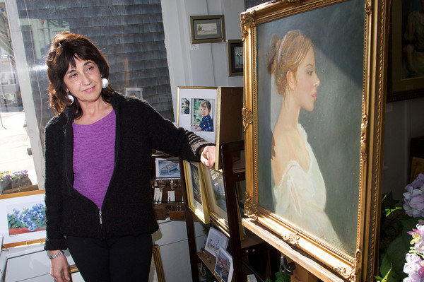 """Luisa F.V. Cleaves stands by a painting titled """"Jacinta"""" in the front of her Rockport Gallery. Photo by Mary Muckenhoupt"""