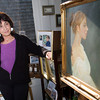 "Luisa F.V. Cleaves stands by a painting titled ""Jacinta"" in the front of her Rockport Gallery. Photo by Mary Muckenhoupt"