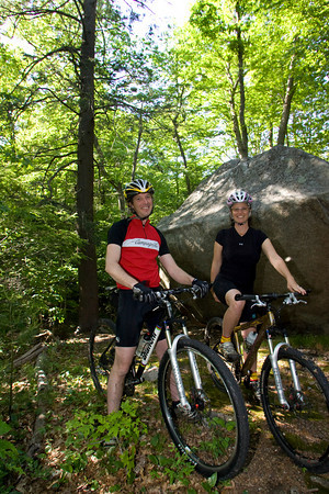 Coley Bryan and his wife Heidi Wakeman of Gloucester take a break from mountain biking while riding the trails by Red Rocks in Gloucester. Photo by Mary Muckenhoupt