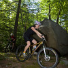 Heidi Wakeman of Gloucester bikes around a big rock while biking the trail at Red Rocks in Gloucester. Photo by Mary Muckenhoupt