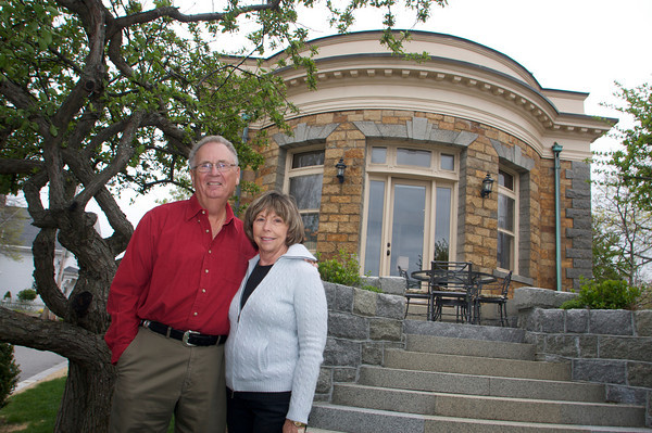 David and Gail Vastola, standing in their front yard, took the dilapidated Carnegie Library in Rockport and turned it into their home. Photo by Mary Muckenhoupt