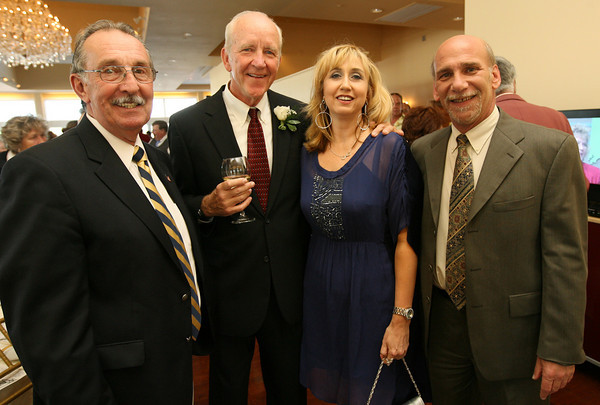 Bob Ryan of CATA, Joe Nogelo, Heidi Dallin of Cape Ann Symphony, and Steve Kaity of the Rotary Club attend Sinikka Nogelo's retirement party at Cruiseport. Photo by Kate Glass