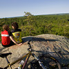 Coley Bryan and his wife Heidi Wakeman of Gloucester take a break from mountain biking at the top of Red Rocks in Gloucester. Photo by Mary Muckenhoupt
