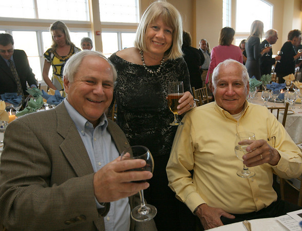 Brad Pierce, owner of the Cape Ann Motor Inn, Ellen Johnson, and Rick Pino attend Sinikka Nogelo's retirement party at Cruiseport. Photo by Kate Glass