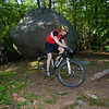 Coley Bryan of Gloucester bikes around a big rock while biking the trail at Red Rocks in Gloucester. Photo by Mary Muckenhoupt
