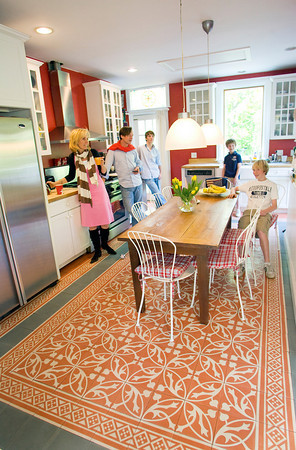 The Roell's hang out in the kitchen of their Rockport home. The tiles of the kitchen floor were shipped over from the Netherlands. Photo by Mary Muckenhoupt