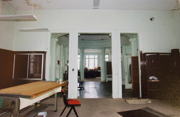 David and Gail Vastola took the dilapidated Carnegie Library in Rockport and turned it into their home. Here shows what the library looked like when the Vastola's purchased it and made this room in the front of the photo a hallways to a master and a guest bedroom.  Photo courtesy of David and Gail Vastola