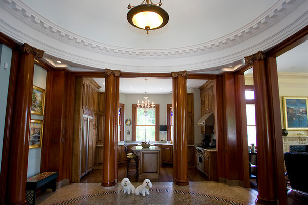 David and Gail Vastola's home that was once the dilapidated Carnegie Library in Rockport. Sitting in the rotunda are the Vastola's poodles Katie and P.D.. Photo by Mary Muckenhoupt