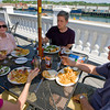 Stacy Bischof, Janet Lewis, Charlie Bischof, and John Lewis enjoy lunch on the patio at Seaport Grille overlooking Gloucester Harbor. Photo by Kate Glass