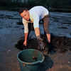 Rich Bonfanti, 24, of Gloucester is digging up clams for selling.<br /> Photo by Desi Smith.