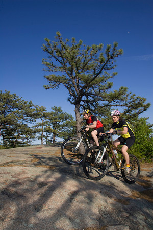 Coley Bryan and his wife Heidi Wakeman of Gloucester ride their mountain bikes at the top of Red Rocks in Gloucester. Photo by Mary Muckenhoupt