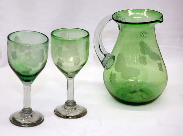 Sit out on the porch, and watch the fireflies dance and hear the crickets chirp as you drink a cool beverage from this green April Comell Handmade Glass Goblets with etched butterflys, $19<br /> pitcher with etched, $42, at GreenLife.