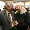 Charles Symonds, Principal of Rockport Middle School, and his wife, Harriet Webster of the Maritime Heritage Center attend Sinikka Nogelo's retirement party at Cruiseport. Photo by Kate Glass