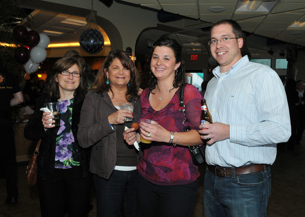 Gloucester: Tracy O'Neil,Sue Pope and Kristen and Rob Parsons enjoy a cocktail at a fund raiser for the GHS Athletics, at Lattatude 45 on Thursday night.Desi Smith Photo/Gloucester Daily Times. April 29,2010.