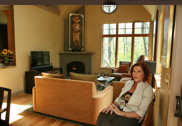 Joyce Fossa sits in the liiving room of her 3 Andrews Hollow home in Rockport<br /> The  colors of living area reflect the color of the granite rocks and boulders just outside the window.<br /> Photo by Amy Sweeney.