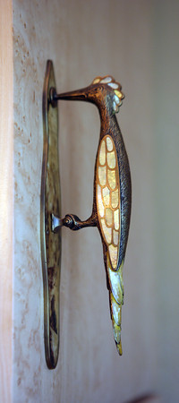 The bathroom's birdeye maple cabinets are adorned with<br /> handles in the shape of turtles and woodpeckers made out of mother-of-pearl<br /> inla.<br /> Photo by Amy Sweeney.