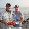 Frank and Sue D'Ambrosio get ready to serve a clam bake to their family and friends.<br /> Amy Sweeney/Staff photo.