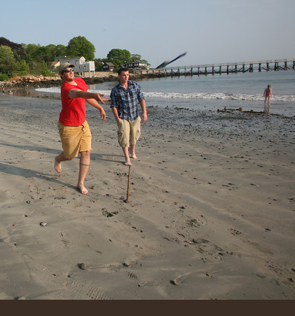 Joel D'Ambrosio and his Eric Smith play horseshoes at Magnolia Beach. Photo by Amy Sweeney