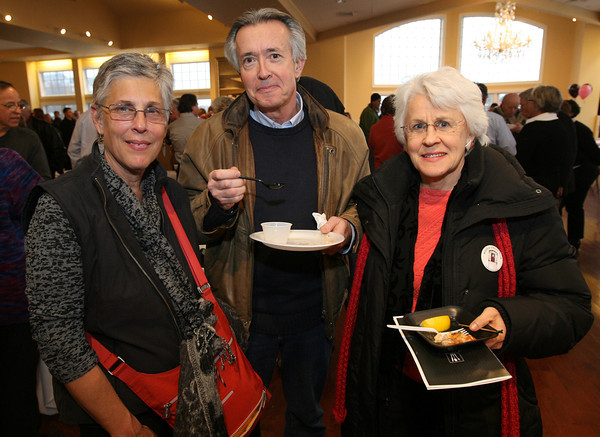 Kate Seidman, Greg Bover, and Frances Fitch sample the food during the 2nd Annual Taste of Cape Ann at Cruiseport on March 23rd. The event, which is sponsored by the Gloucester Daily Times and Cape Ann Magazine, is a fundraiser for the Open Door Food Pantry and Cape Ann Animal Aid. Photo by Kate Glass