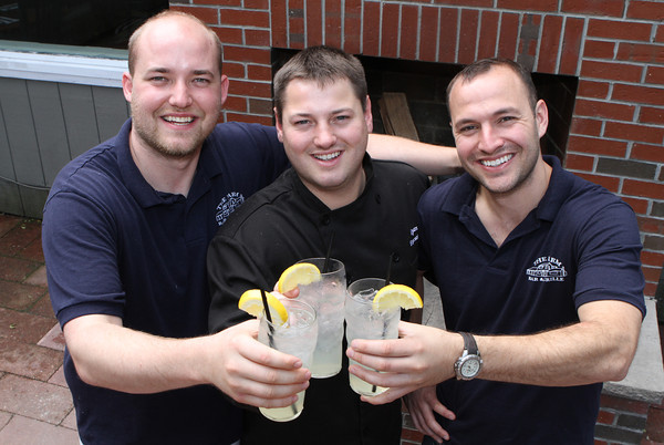Brad Atkinson co-owner, (left), Ryan Cox Executive Chef and co-owner (center) Noah Goldstein co-owner of The Farm Bar & Grille. Photo by David Le.