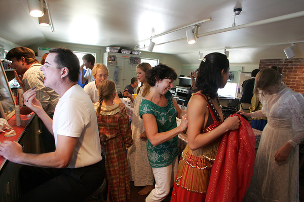 It's make-up frenzy as committee members assist cast members with make up and costumes as the day's first show approaches. The mission: look like you're made of wax.<br /> One of the highlights of the Annisquam Village Sea Fair is the WaxWorks. Photo by Mary Muckenhoupt.