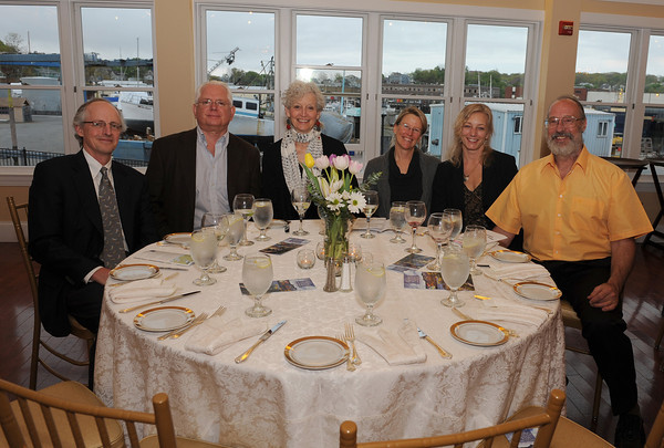 Gloucester:  Wilhelm Merck, Ed Bowers, Ruth Mordecai, Nonie Brady, Karen Rishben, and Ken Parker pose for a photo at the Gloucester Stage Company Gala held at Cruiseport Friday May 20th. Desi Smith/Gloucester Daily Times.