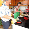 Vito Piscitello passes down his tradition of cooking Eggplant Parmigiana to his daughter,  Tonianne, for Fiesta. Photo by Desi Smith.