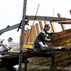 Photo by Angie Beaulieu. Volunteers Chuck Redman and James Green work on the Schooner Ardelle.