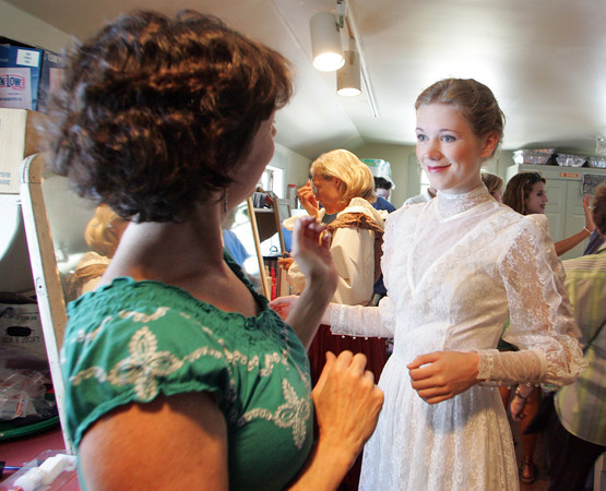 "Cheryl Thurman puts the finishing touches on daughter Mollie, who is set to play Grace Kelly from the 1952 Academy Award-winning film, ""High Noon."" during the 2010 WaxWorks, which is one of the highlights of the Annisquam Village Sea Fair is the WaxWorks show. Photo by Mary Muckenhoupt."