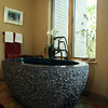 The centerpiece of the master bathroom of Joyce Fossa's home is a solid<br /> egg-shaped dark granite bath tub.<br /> Photo by Amy Sweeney