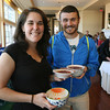 Dawn Godow of Cape Ann Art Haven and Mat Schetne carry their soup to a table during the Empty Bowl Dinner at Cruiseport on May 12th. All proceeds from the event benefit the Open Door Food Pantry. Photo by Kate Glass
