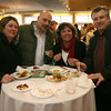 Lily Salah, Dean Salah, Judy Doyle and John Doyle sample food and drinks during the 2nd Annual Taste of Cape Ann at Cruiseport on March 23rd. The event, which is sponsored by the Gloucester Daily Times and Cape Ann Magazine, is a fundraiser for the Open Door Food Pantry and Cape Ann Animal Aid. Photo by Kate Glass