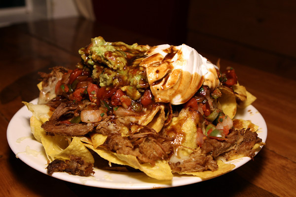 The restaurant's menu is rich with options, beginning with amazing appetizers. BBQ Nachos feature hand-cut tortilla chips, melted cheddar cheese.<br /> The Farm Bar & Grille in Essex.<br /> Photo by David Lee
