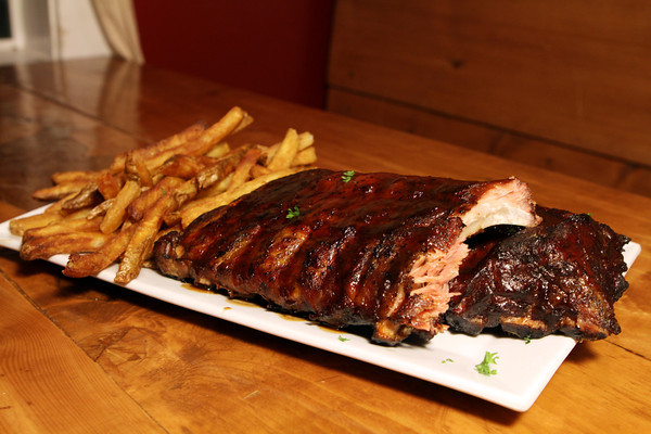 BBQ Ribs Full Rack served with hand cut fries at The Farm Bar & Grill.<br /> David Le.