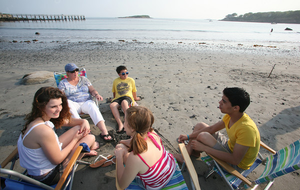 Nicole D'Ambrosio, left, sits with her mother Sue, brother Jake and friends LIza Marie Parsons and Leo Rivera during a clam bake at Magnolia Beach.<br /> Photo by Amy Sweeney.