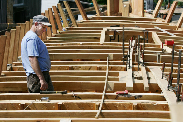 Photo by Angie Beaulieu. Harold Burnham works on the Schooner Ardelle