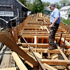 Photo by Angie Beaulieu. Harold Burnham works on the Schooner Ardelle in Essex.