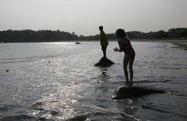 Jessica Cooney 6, plays in the water with Jake D'Ambrosio, 10, at Magnolia Beach.<br /> Photo by Amy Sweeney.