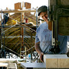 Photo by Angie Beaulieu. Harold Burnham works on the Schooner Ardelle.