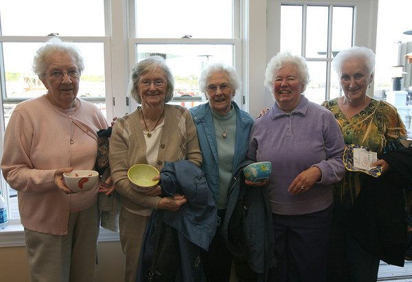 Lois Dench, Kay Poole, Dolly Kinghorn, Judy Williams, and Lois Stillman show off the bowls they selected during the Empty Bowl Dinner at Cruiseport on May 12th. All proceeds from the event benefit the Open Door Food Pantry. Photo by Kate Glass