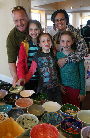 Jason Grow, his wife Sarah, and their three daughters, Matilda, Jemima and Maisie, select bowls during the Empty Bowl Dinner at Cruiseport on May 12th. All proceeds from the event benefit the Open Door Food Pantry. Photo by Kate Glass