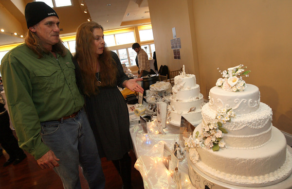 "Gloucester resident and former ""Survivor: Nicaragua"" contestant James Tarantino aka ""Jimmy T"" and his wife, Laurel, check out the cakes made by Cakes by Barbara during the 2nd Annual Taste of Cape Ann at Cruiseport on March 23rd. The event, which is sponsored by the Gloucester Daily Times and Cape Ann Magazine, is a fundraiser for the Open Door Food Pantry and Cape Ann Animal Aid. Photo by Kate Glass"