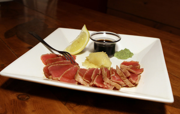 Tuna Tataki (Lightly Seared Fresh Tuna served with Wasabi, Ginger and Soy Sauce) at The Farm Bar & Grill in Essex.<br /> Photo by David Le.