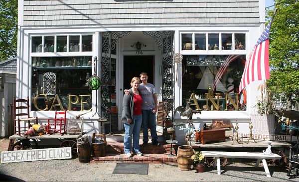 "Catherine [Howard] Galli and her son,  Michael Galli. stand outside their family owned antique shop Howard's Flying Dragon in Essex. ""We had these large gold letters we wanted to sell, and I just happened to put some in the window as a display; I don't even remember the first thing I wrote,"" Catherine recalls. ""But it started catching on."" She wrote Cape Ann for Cape Ann Magazine.<br /> Photo by Amy Sweeney."
