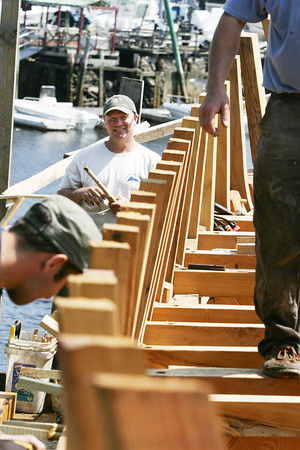 Photo by Angie Beaulieu. Volunteer Chuck Redman works on the Schooner Ardelle.