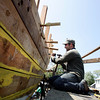 Photo by Angie Beaulieu. Volunteer James Green works on the Schooner Ardelle.