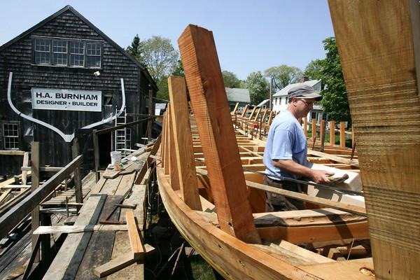 Harold Burnham works on the Schooner Ardelle.