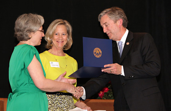 Courtesy photo/Gloucester Daily Times. Gloucester: At the Women Honoring Women Luncheon on May 7.  Congressman John Tierney presents a 30th Anniversary Citation to Wellspring's Executive Director Kay O'Rourke as Board Chair Caroline Hovey looks on.