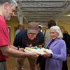 Jim Flink President of the Lanesville Community Center (center) blows out the candles on his Birthday cake.  Desi smith Photo